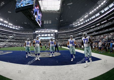 Tyron Smith, Connor Williams, Travis Frederick, Zack Martin, La'el Collins. Dallas Cowboys' La'el Collins (71), Zack Martin (70), Travis Frederick (72), Connor Williams (52) and Tyron Smith (77) warm up before a NFL football game against the New York Giants in Arlington, Texas