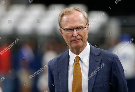 New York Giants team owner John Mara watches the team warm up before a NFL football game against the Dallas Cowboys in Arlington, Texas