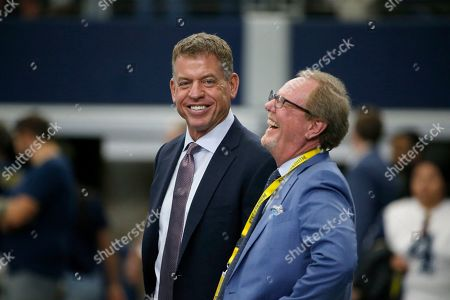 Ed Werder, Troy Aikman. Broadcast personality Troy Aikman, left, talks with sports reporter Ed Werder, right, before a NFL football game between eh New York Giants and Dallas Cowboys in Arlington, Texas