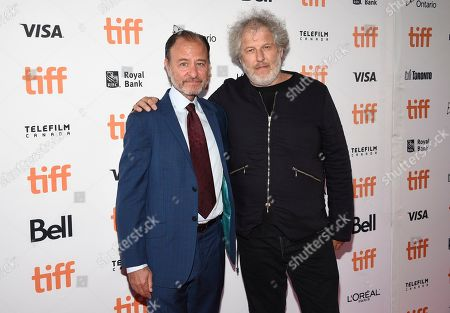 "Fisher Stevens, Malcolm Venville. Fisher Stevens, left, and Malcolm Venville attend a premiere for ""And We Go Green"" on day four of the Toronto International Film Festival at the Ryerson Theatre, in Toronto"