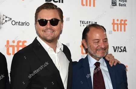 "Leonardo DiCaprio, Fisher Stevens. Leonardo DiCaprio, left, and Fisher Stevens attend a premiere for ""And We Go Green"" on day four of the Toronto International Film Festival at the Ryerson Theatre, in Toronto"