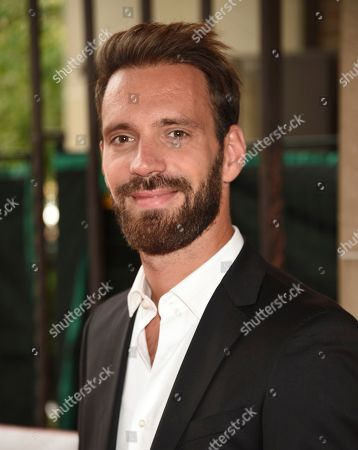 """Professional race car driver Jean-Eric Vergne attends a premiere for """"And We Go Green"""" on day four of the Toronto International Film Festival at the Ryerson Theatre, in Toronto"""