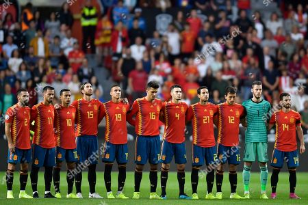 Spain team players stand during a minute of silence for former coach Luis Enrique's daughter Xana who died recently before the Euro 2020 group F qualifying soccer match between Spain and Faroe Islands at the Molinon, stadium in Gijon, Spain
