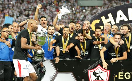 Zamalek's Shikabala (L) and teammates celebrate with the trophy after winning the Egyptian Cup final soccer match between Zamalek SC and Pyramids FC at Borg Al-Arab Stadium in Alexandria, Egypt, 08 September 2019.