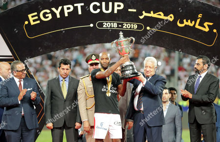 Stock Photo of Zamalek's Shikabala (C) receives the trophy after winning the Egyptian Cup final soccer match between Zamalek SC and Pyramids FC at Borg Al-Arab Stadium in Alexandria, Egypt, 08 September 2019.