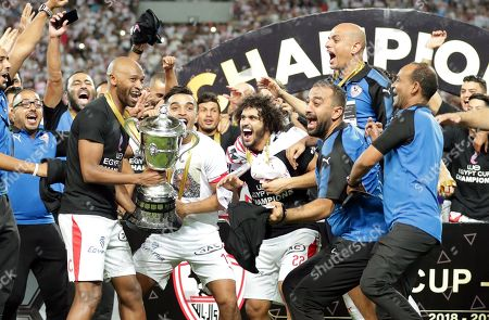 Stock Picture of Zamalek's Shikabala (3-L) and teammates celebrate with the trophy after winning the Egyptian Cup final soccer match between Zamalek SC and Pyramids FC at Borg Al-Arab Stadium in Alexandria, Egypt, 08 September 2019.