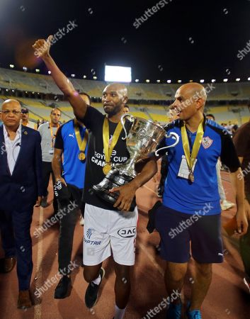 Zamalek's Shikabala (C) celebrates with the trophy after winning the Egyptian Cup final soccer match between Zamalek SC and Pyramids FC at Borg Al-Arab Stadium in Alexandria, Egypt, 08 September 2019.