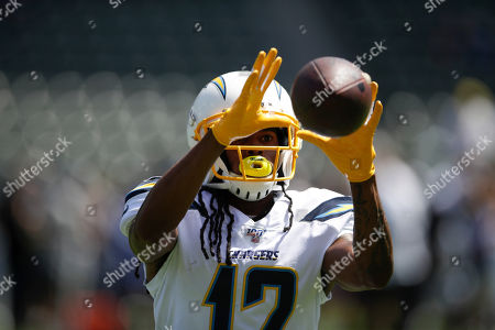 Los Angeles Chargers wide receiver Travis Benjamin warms up before against the Indianapolis Colts an NFL football game, in Carson, Calif