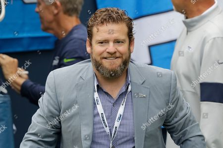 Seattle Seahawks general manager John Schneider stands on the sideline before an NFL football game against the Cincinnati Bengals, in Seattle