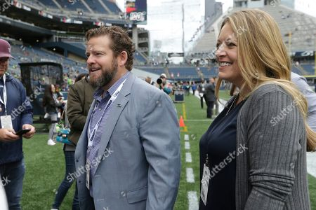 Stock Photo of Seattle Seahawks general manager John Schneider and his wife Traci stand on the sideline before an NFL football game against the Cincinnati Bengals, in Seattle
