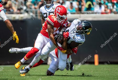 Jacksonville, FL, U.S: Jacksonville Jaguars wide receiver Chris Conley (18) is tackled by Kansas City Chiefs cornerback Juan Thornhill (22) during 1st half NFL football game between the Kansas City Chiefs and the Jacksonville Jaguars at TIAA Bank Field in Jacksonville, Fl