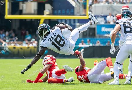 Jacksonville, FL, U.S: Jacksonville Jaguars wide receiver Chris Conley (18) is upended by Kansas City Chiefs cornerback Juan Thornhill (22) during 1st half NFL football game between the Kansas City Chiefs and the Jacksonville Jaguars at TIAA Bank Field in Jacksonville, Fl