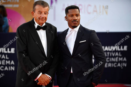 Stock Picture of Tunisian film producer and distributor Tarak Ben Ammar (L) and US actor and director Nate Parker arrive on the red carpet prior to the premiere of 'Waiting for the Barbarians' during the 45th Deauville American Film Festival, in Deauville, France, 08 September 2019. The festival runs from 06 to 15 September.
