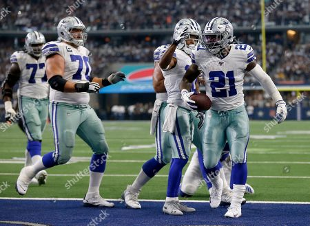 Tyron Smith, Zack Martin, Tavon Austin, Ezekiel Elliott. Dallas Cowboys' Tyron Smith (77), Zack Martin (70) and Tavon Austin, second from right, celebrate with Ezekiel Elliott (21) after his touchdown run in the second half of a NFL football game against the New York Giants in Arlington, Texas