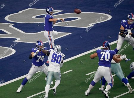 Eli Manning, Mike Remmers, Demarcus Lawrence. New York Giants quarterback Eli Manning (10) throws a pass as offensive guard Mike Remmers helps against pressure from Dallas Cowboys defensive end Demarcus Lawrence (90) in the first half of a NFL football game in Arlington, Texas