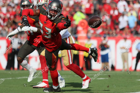 Tampa Bay Buccaneers cornerback Carlton Davis (33) breaks up a pass during the NFL game between the San Francisco 49ers and the Tampa Bay Buccaneers held at Raymond James Stadium in Tampa, Florida. Andrew J