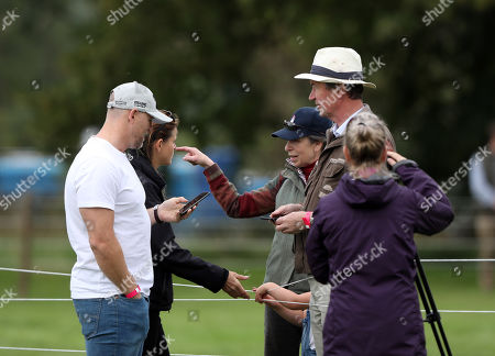 Mike Tindall, with mother-in-law Princess Anne (Princess Royal) and Sir Tim Laurence, before watching Zara Tindall, who is competing on Class Affair, on cross country day