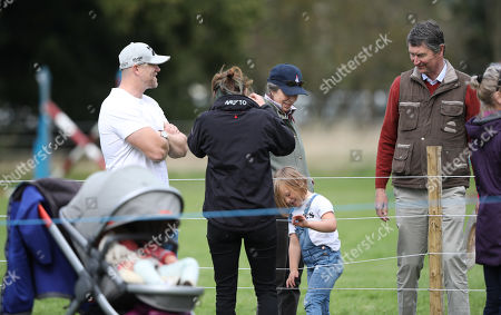 Mike Tindall, with mother-in-law Princess Anne (Princess Royal) watching Mia Grace Tindall, and Sir Tim Laurence before watching Zara Tindall, who is competing on Class Affair, on cross country day