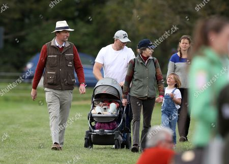 Mike Tindall, with mother-in-law Princess Anne (Princess Royal) with Mia Grace Tindall, and Sir Tim Laurence before watching Zara Tindall, who is competing on Class Affair, on cross country day