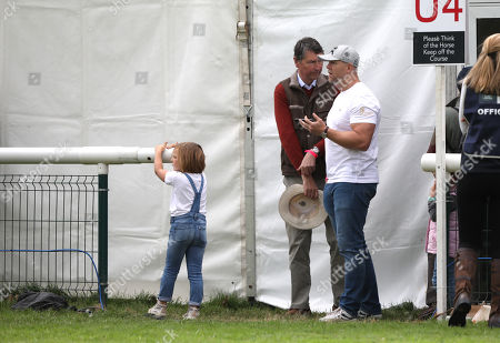 Mike and Mia Tindall, with Sir Tim Laurence, before watching Zara Tindall, who is competing on Class Affair, on cross country day