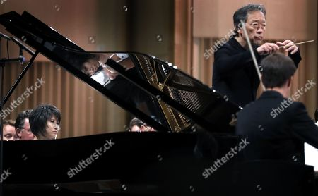 Chinese classical pianist Yuja Wang, accompanied by The Staatskapelle Dresden orchestra under the batton of South Korean conductor Myung-whun Chung (R), performs Rachmaninoff's Piano Concerto no. 3 in D minor op. 30 the stage of Grand Concert Hall during the George Enescu International Festival 2019, in Bucharest, Romania, 08 September 2019. The festival, held since 1958 every two years, is the biggest classical music festival held in Romania, in honor of Romanian composer and violinist George Enescu. The 24th edition of the George Enescu International Festival takes place between 31 August and 22 September 2019.