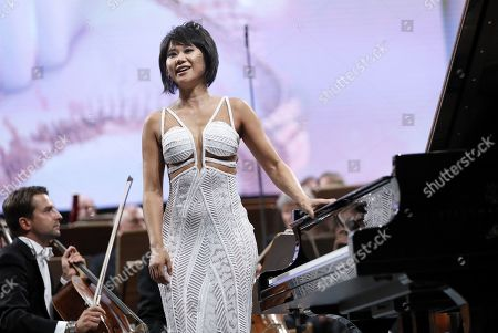 Chinese classical pianist Yuja Wang, backed by The Staatskapelle Dresden orchestra, greets the audience after performing Rachmaninoff's Piano Concerto no. 3 in D minor op. 30 the stage of Grand Concert Hall during the George Enescu International Festival 2019, in Bucharest, Romania, 08 September 2019. The festival, held since 1958 every two years, is the biggest classical music festival held in Romania, in honor of Romanian composer and violinist George Enescu. The 24th edition of the George Enescu International Festival takes place between 31 August and 22 September 2019.