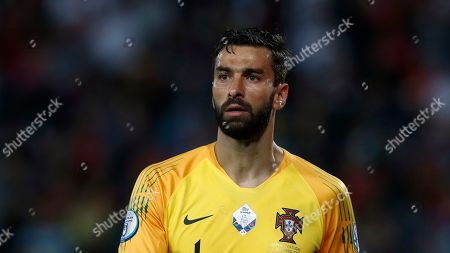 Portugal goalkeeper Rui Patricio looks out during the Euro 2020 group B qualifying soccer match between Serbia and Portugal, on the stadium Rajko Mitic in Belgrade, Serbia