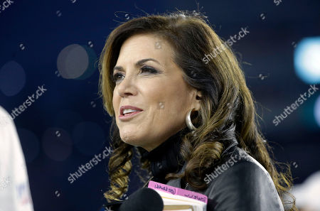 Broadcaster Michele Tafoya walks on the field before an NFL football game between the Pittsburgh Steelers and the New England Patriots, in Foxborough, Mass