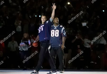 Stock Photo of Former New England Patriots Rob Gronkowski, left, and Martellus Bennett are introduced before an NFL football game between the Patriots and the Pittsburgh Steelers, in Foxborough, Mass