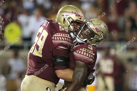 Stock Picture of Cam Akers, Brady Scott. Florida State's Cam Akers, right, gets a hug from Brady Scott after scoring during an NCAA college football game with Louisiana-Monroe, in Tallahassee Fla. Florida State won in overtime 45-44