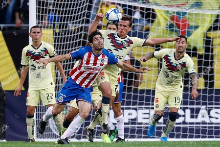 Chivas de Guadalajara's Antonio Briseno, second from left, is guarded by Club America's Fernando Gonzalez, second from right, as Club America's Paul Aguilar, left, and Club America's Emmanuel Aguilera look on during the first half of a Super Clasico soccer match, in Chicago
