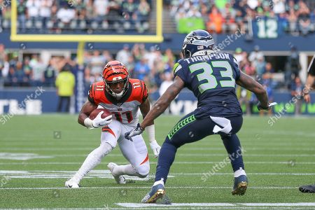 Seattle Seahawks safety Tedric Thompson (33) tries to tackle Cincinnati Bengals wide receiver John Ross III (11) on an attempt to pick up a first down during a game between the Cincinnati Bengals and Seattle Seahawks at CenturyLink Field in Seattle, WA. The Seahawks won 21-20