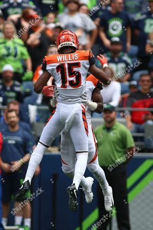 Cincinnati Bengals wide receiver John Ross III (11) and Cincinnati Bengals wide receiver Damion Willis (15) celebrate Ross' touchdown during a game between the Cincinnati Bengals and Seattle Seahawks at CenturyLink Field in Seattle, WA. The Seahawks won 21-20
