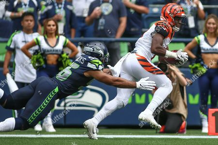 Seattle Seahawks linebacker Mychal Kendricks (56) tries to tackle Cincinnati Bengals wide receiver John Ross III (11) before Ross scored a touchdown during a game between the Cincinnati Bengals and Seattle Seahawks at CenturyLink Field in Seattle, WA. The Seahawks won 21-20