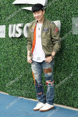 JJ Lin attends the men's finals of the U.S. Open tennis championships, in New York