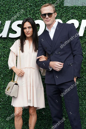 Jennifer Connelly, Paul Bettany. Jennifer Connelly, left, and Paul Bettany attend the men's finals of the U.S. Open tennis championships, in New York