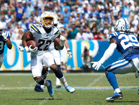 Los Angeles Chargers running back Justin Jackson (22) carries the ball as Indianapolis Colts free safety Malik Hooker (29) defends during the NFL game between the Los Angeles Chargers and the Indianapolis Colts at Dignity Health Sports Park in Carson, California