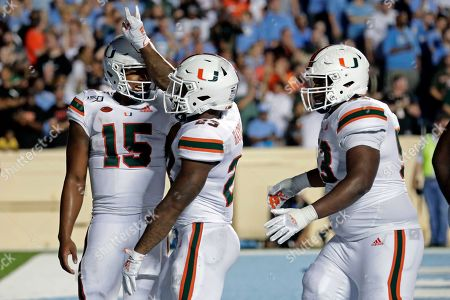Cam'Ron Harris, Jarren Williams, Jakai Clark. Miami's Cam'Ron Harris (23), center, celebrates with Jarren Williams (15) and Jakai Clark (53) after he scored a touchdown during the third quarter of an NCAA college football game against North Carolina in Chapel Hill, N.C., on