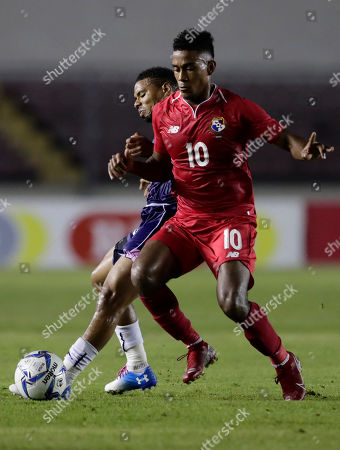 Panama's Edgar Barcenas, front, and Bermuda's Reginal Thompson-Lambe vie for the ball during a Concacaf Nation League soccer match at Rommel Fernandez stadium in Panama City