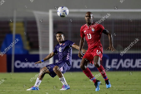 Stock Photo of Bermuda's Zeiko Lewis, left, and Panama's Adolfo Machado watches the ball during a Concacaf Nation League soccer match at Rommel Fernandez stadium in Panama City