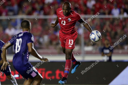 Panama's Adolfo Machado, center, jumps for a header next to Bermuda's Reginal Thompson-Lambe during a Concacaf Nation League soccer match at Rommel Fernandez stadium in Panama City