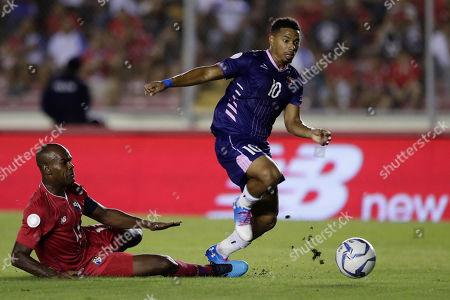 Bermuda's Zeiko Lewis, rights, dribbles the ball pressured by Panama's Adolfo Machado during a Concacaf Nation League soccer match at Rommel Fernandez stadium in Panama City