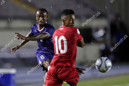 Bermuda's Donte Brangman, left, strikes the ball pressured by Panama's Edgar Barcenas during a Concacaf Nation League soccer match at Rommel Fernandez stadium in Panama City