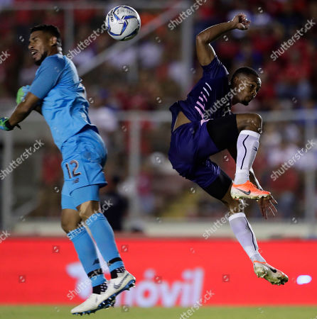 Bermuda's Justin Donawa, right, and Panama's goalkeeper Jose Calderon fight for the ball during a Concacaf Nation League soccer match at Rommel Fernandez stadium in Panama City