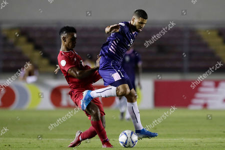 Bermuda's Reginald Thompson-Lambe, right, and Panama's Edgar Barcenas compete for the ball during a Concacaf Nation League soccer match at Rommel Fernandez stadium in Panama City