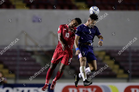 Bermuda's Oliver Harvey, right, heads the ball challenged by Panama's Edgar Barcenas during a Concacaf Nation League soccer match at Rommel Fernandez stadium in Panama City
