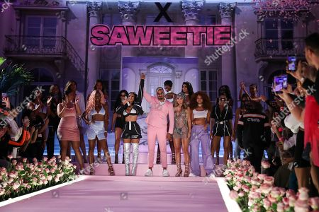 Stock Photo of Saweetie and Umar Kamani on the catwalk