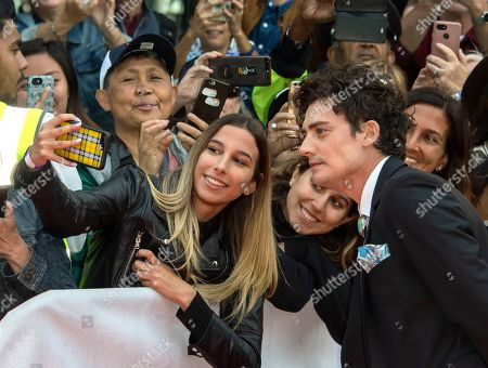 Aneurin Barnard (R) poses for a photograph with a fan as he arrives for the screening of the movie 'The Goldfinch' during the 44th annual Toronto International Film Festival (TIFF) in Toronto, Canada, 08 September 2019. The festival runs 05 to 15 September.