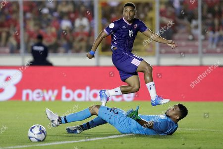 Zeiko Lewis (top) of Bermuda in action against against goalkeeper Jose Calderon (bottom) of Panama during a CONCACAF Nations League soccer match between Panama and Bermuda at the Rommel Fernandez National Stadium in Panama City, Panama, 08 September 2019.