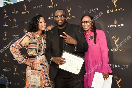 Stock Image of Lesley Nicole Lewis, Luther Brown, Eboni Nichols. From left to right, Lesley Nicole Lewis, nominee Luther Brown, and Television Academy Governor Eboni Nichols at the Television Academy Choreography Nominee Reception on at the Television Academy in North Hollywood, Calif